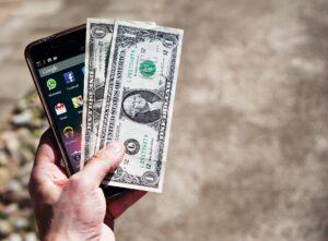 Dollar och mobiltelefon